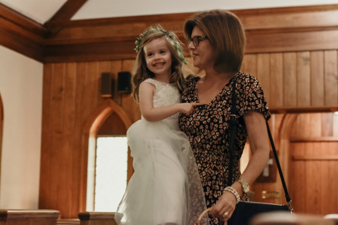 Evangeline (niece) served as flower girl with the help of her Granny Michelle (our family's pastor and friend).